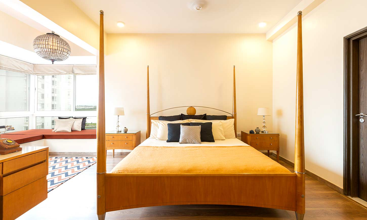 A master bedroom with rustic design for apartment interiors in bangalore