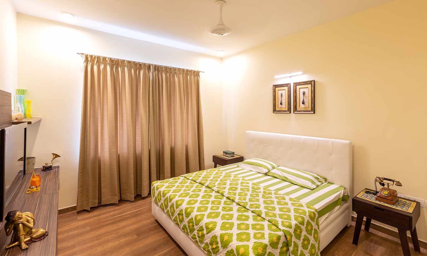 Top interior decorators in bangalore for green bedroom with white bed