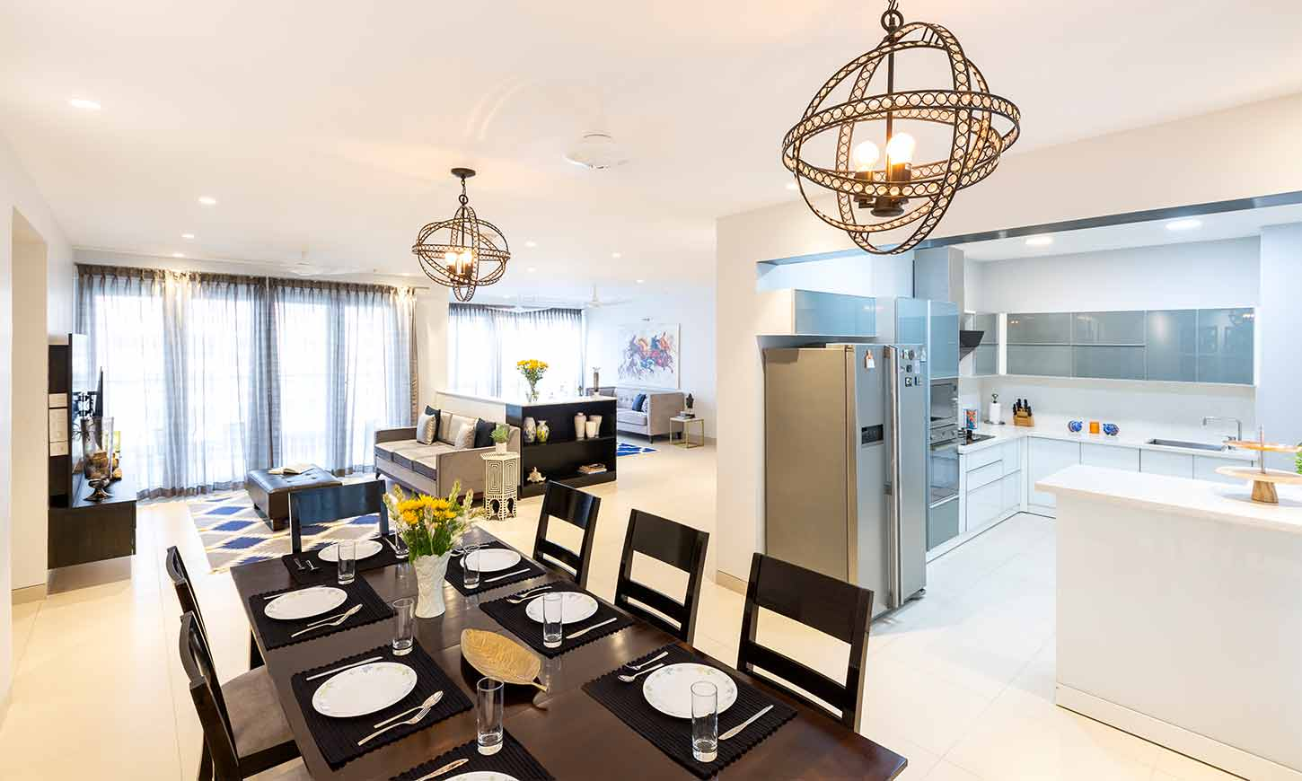 A dining area with kitchen designed by one of the best interior designing companies in bangalore