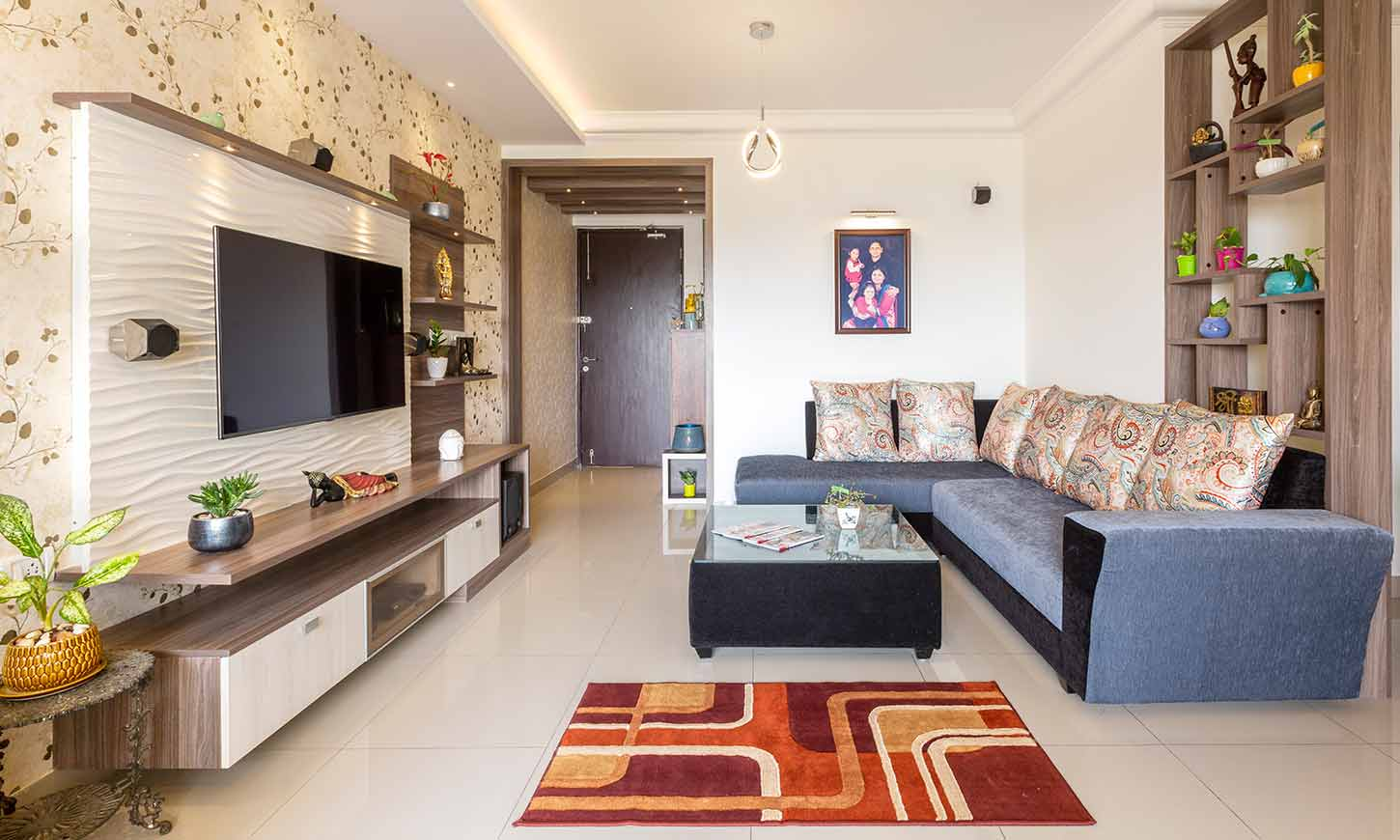 Living room designed by budget interiors in bangalore with tv unit and showcase