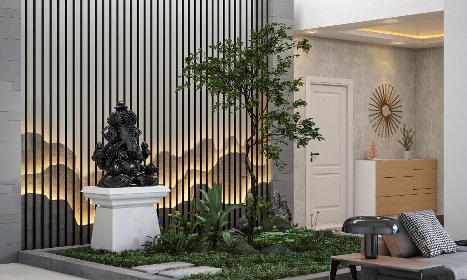 Vastu Ganesha Entrance in drawing room with a golden statue of vastu ganesha photo