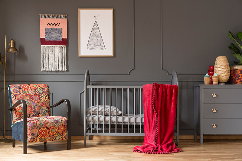 Baby nursery designs for your home with colourful accessories and a space to hang decor items for nursery design ideas boy