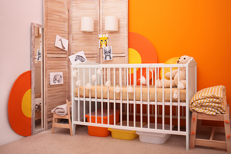 Nursery room design with dazzle colours mounted with frames in designer nursery decor