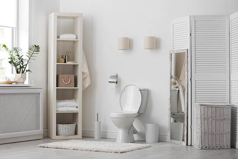 Bathroom storage cabinet for your home with open shelving racks placed against the wall with bathroom storage rack