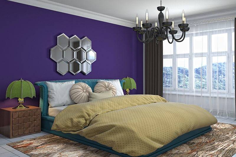 Indian style bedroom interior design with a mix of bold colours and ethnic prints