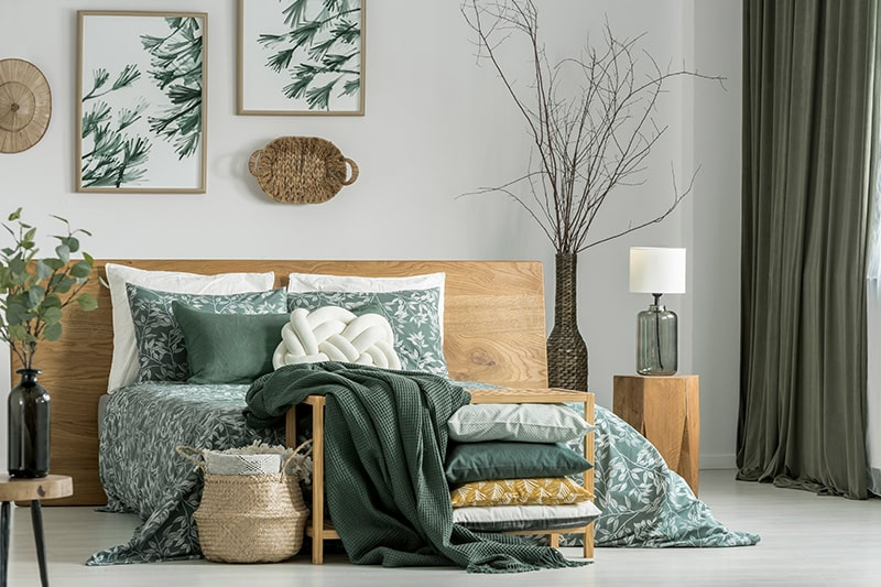 Indian style bedroom designs with a groovy green wallpapers and large airy windows to make marvellous bedroom design in india