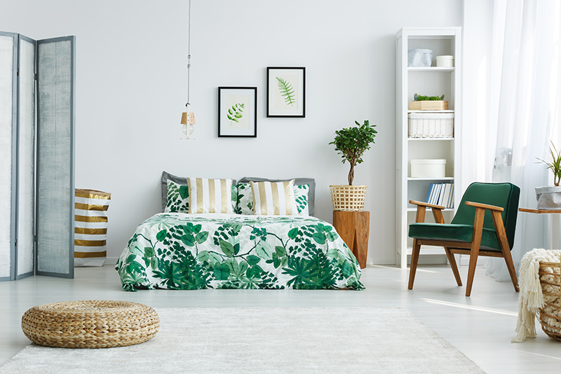 bedroom decoration with a combination of tropical footprints and pillow covers are best bedroom  decor ideas