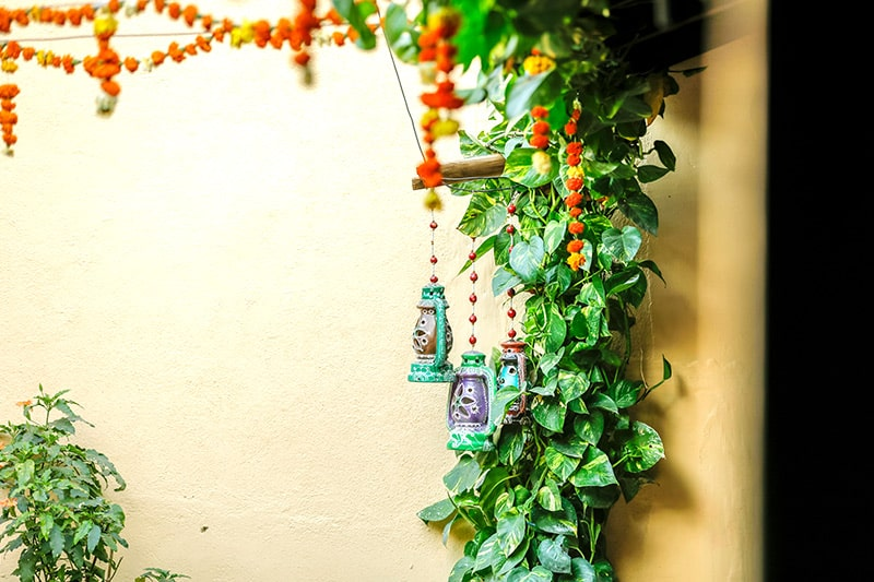 Sankranti decorations at home with a mango leaves and hang them on the entrance of your home