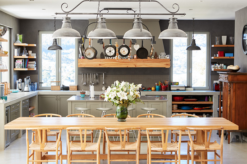 Open kitchen design with dining room integrated together as a new trend with digital homes