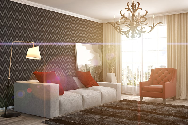 The dark coloured living room wallpaper brings in grandeur to your living room