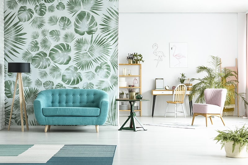 Living room wallpaper design with prints of green gives a fresh look for living room interiors