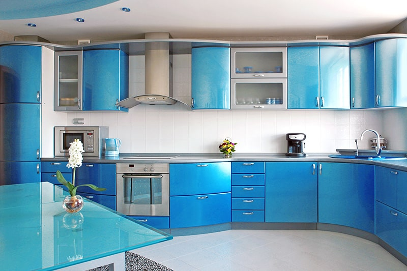 Blue kitchen cupboards design with smooth curves to resemble fluidity of ocean w waves