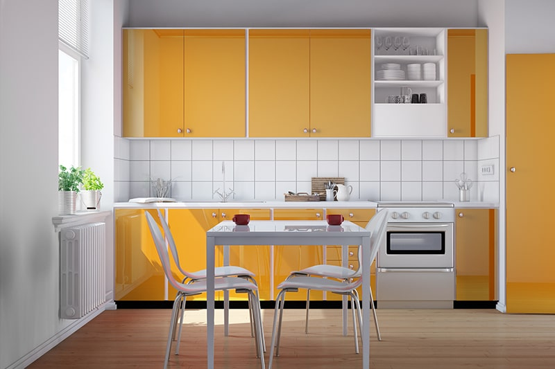 Yellow and white color kitchenettes gives your kitchenettes more spacious and airy