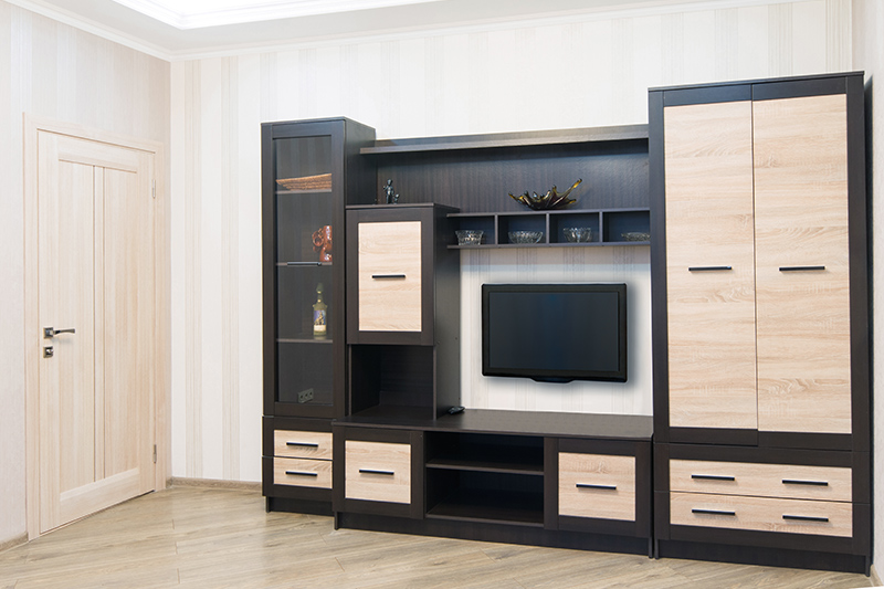 Wardrobe with tv unit design where a wooden laminate adds a classic touch to