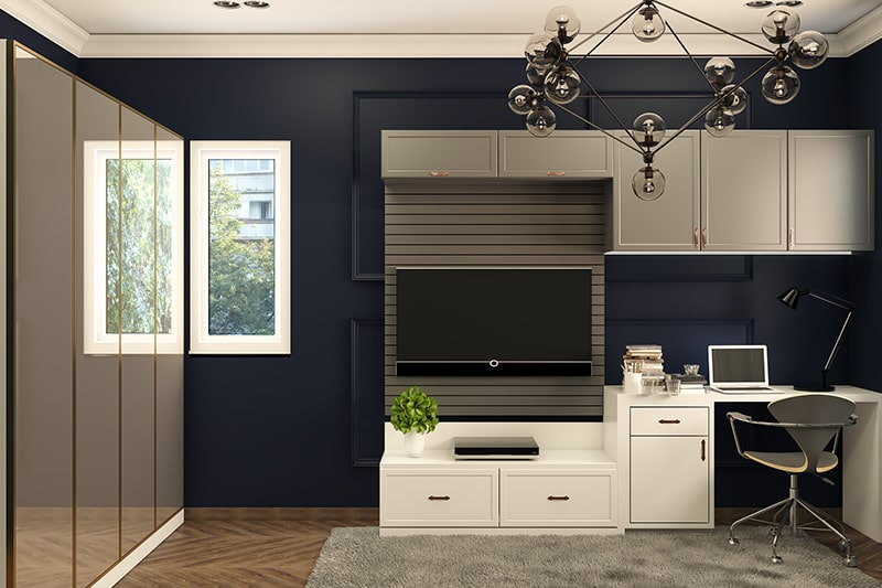 Midnight blue paint colors creates an ultra luxe feel in an ordinary home office with blue wall paint colors