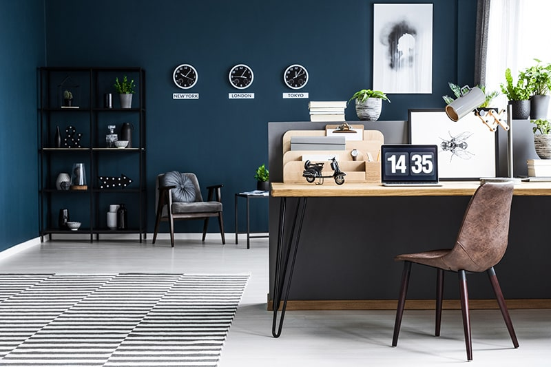 Navy blue paint colors create a sense of visual drama in your home office