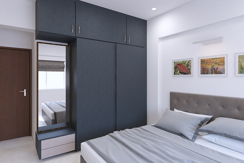 Two door wardrobe with attached dressing table blends with your bedroom's interiors