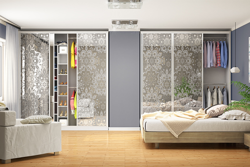 Patterned glass door wardrobe design is uniquely designed and divided into separate sections with a wall divider