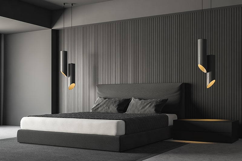 Black bedroom walls with wooden or metal stripes instead of painting in black