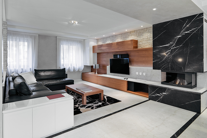 Marble tiles for living room where classic white marble flooring can be accentuated by the use of lines that double up at partitioning of spaces.