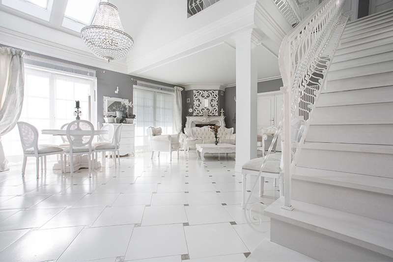 White marble flooring designs for living room looks gorgeous when scattered with a diamond motif.