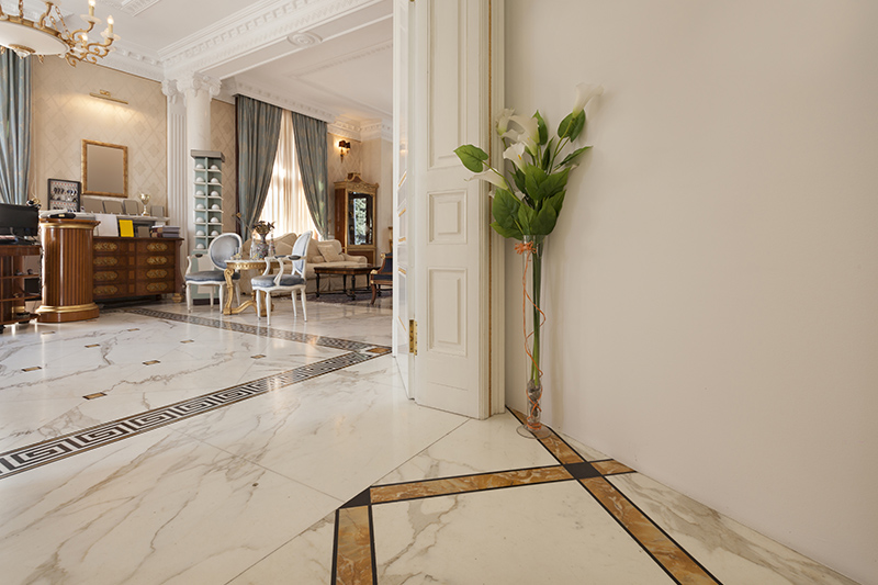 Try marble flooring pattern by mixing it up with another cool one to separate the entrance and living room marble tiles.
