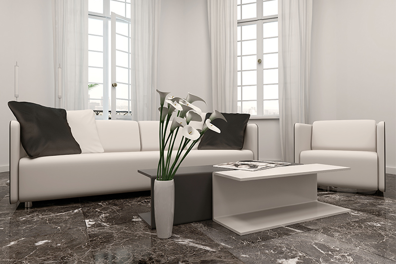 Straight lay marble tiles in a dark shade are a great option for your living room marble flooring design.