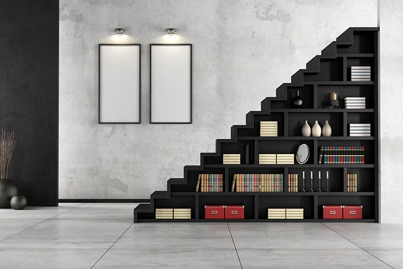 Stairs with extra shelving for extra storage under the staircase is a types of space saving staircases
