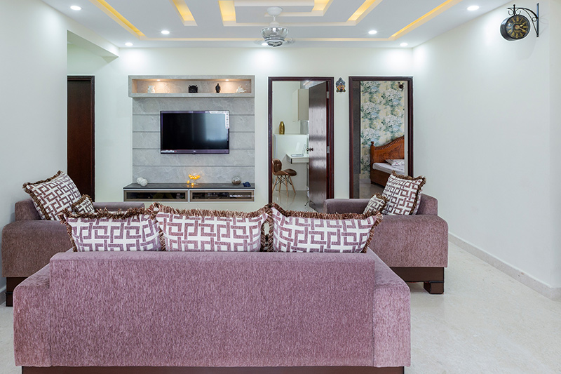 Small house living room design adds geometric-structured false ceiling that looks a lot like a character and style.