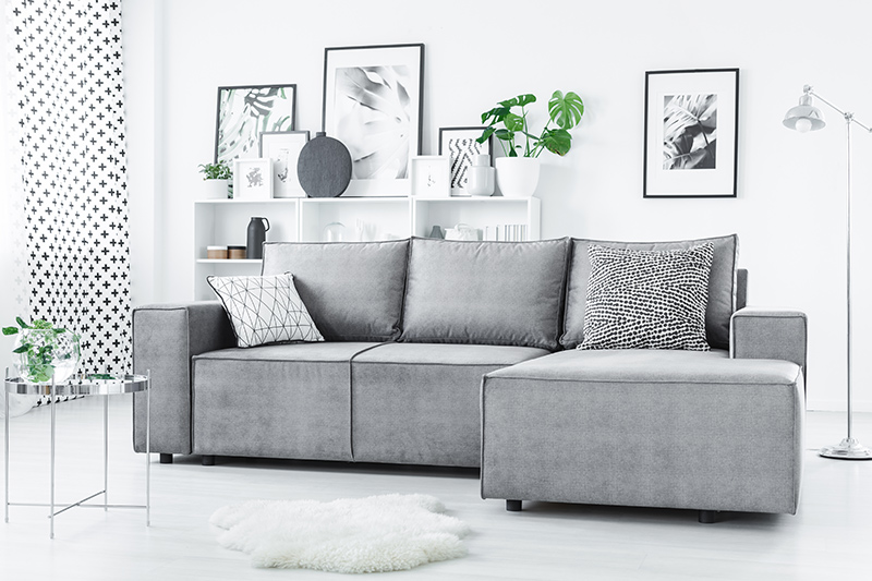 Corner sofa design for small living room that is minimalistic and helps maximise your living room area.
