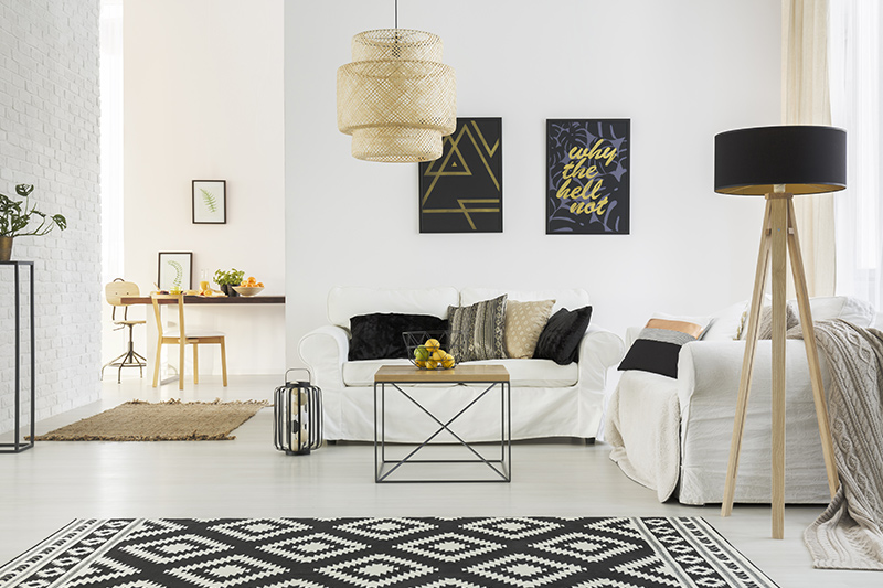 Luxury living room ideas where mixing and matching furniture in a cohesive manner create a luxury look.