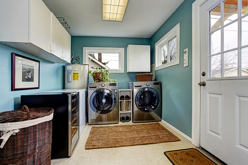 Laundry room painted in a beautiful aqua tone in a shades of the ocean