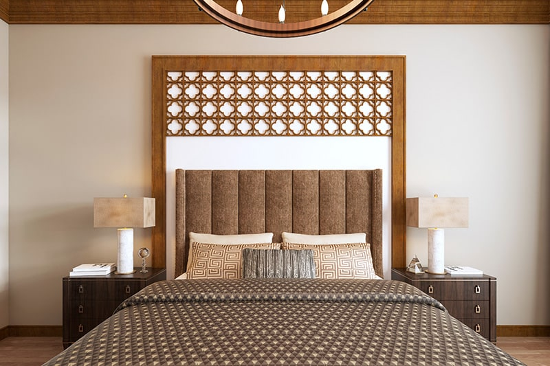 An ornately wooden designed gives luxury and class look to your bedroom