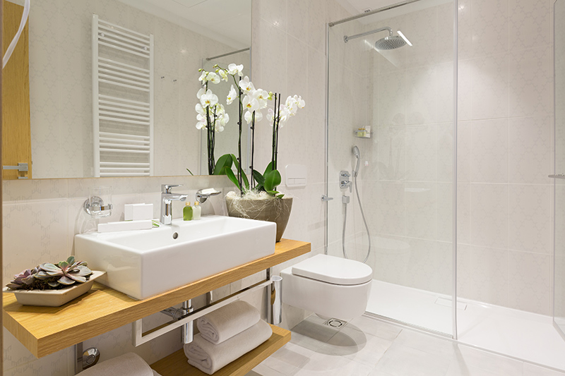 Replace curtain and add glass panel to small bathroom designs with shower to look clean.