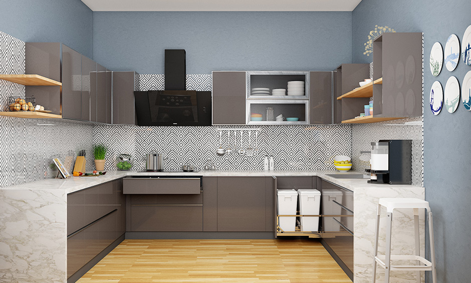 Angular kitchen chimney looks bold and stylish with this grey-themed and blends well with the light hardwood flooring.