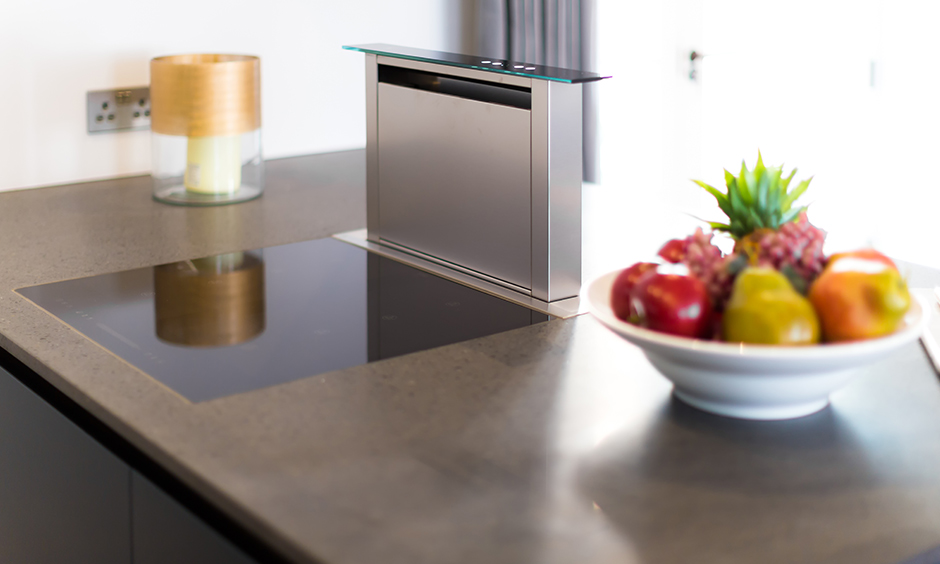 Kitchen chimney downdraft is intelligently-designed and saves space on the granite kitchen countertop.