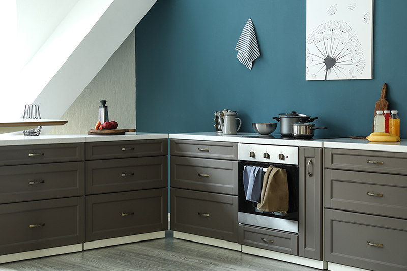 Small kitchen paint colors combination of the shade of blue, grey and brass elements works well.