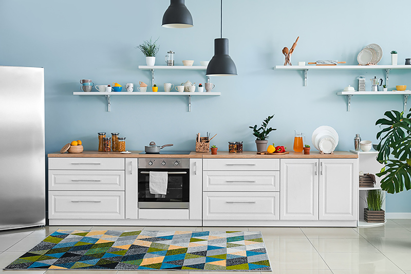 Kitchen wall paint color ideas pair ice blue with darker colours for a slightly glamorous look.