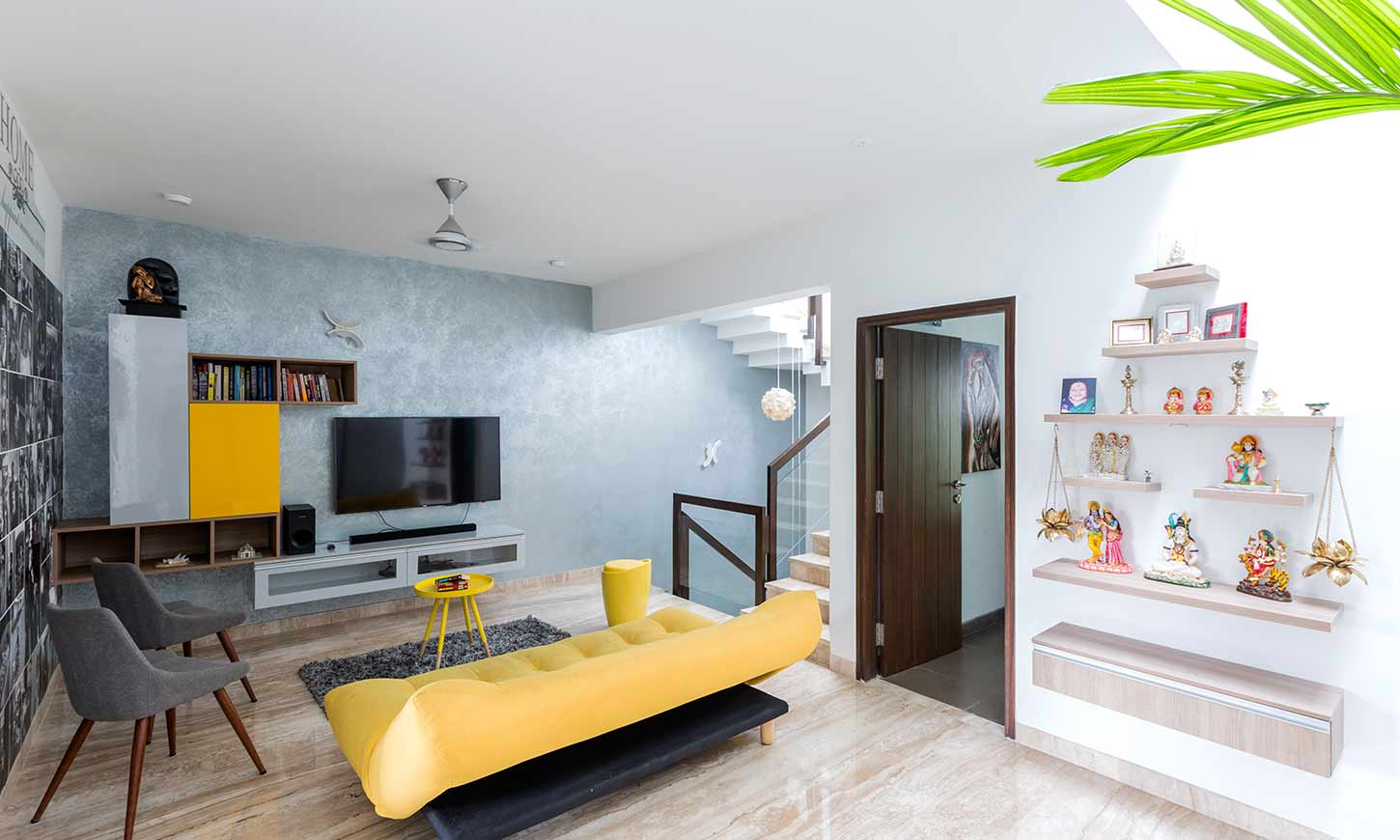 Good interior designers in bangalore with a bold yellow sofa in living room