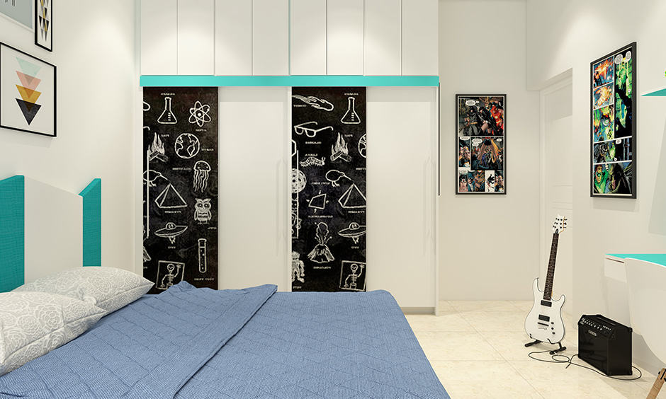 Kids room storage ideas with a wardrobe with doors made of chalkboard.