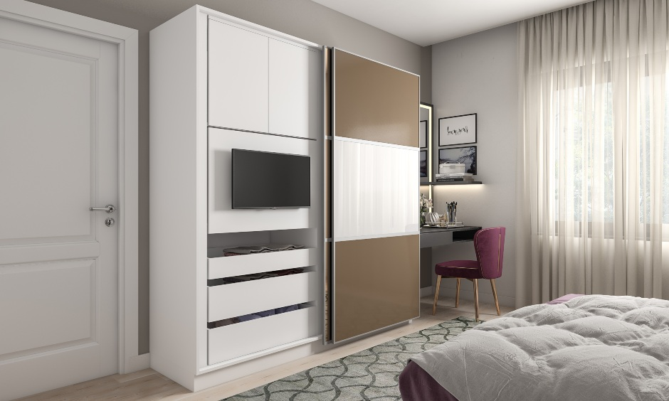 Wardrobe design for bedroom with a white and brown sliding door wardrobe with an in-built tv unit