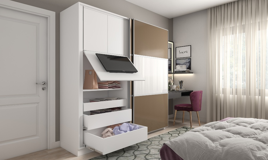Wardrobe design with a flip up tv panel, sliding doors with hidden storage is perfect for small rooms