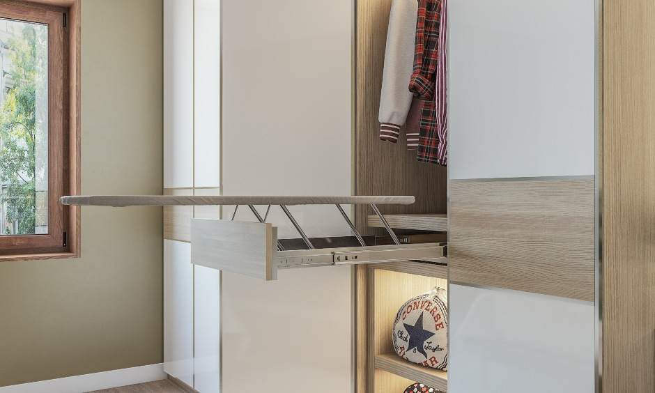 A white wardrobe design with an in-built iron board suitable for kids bedroom
