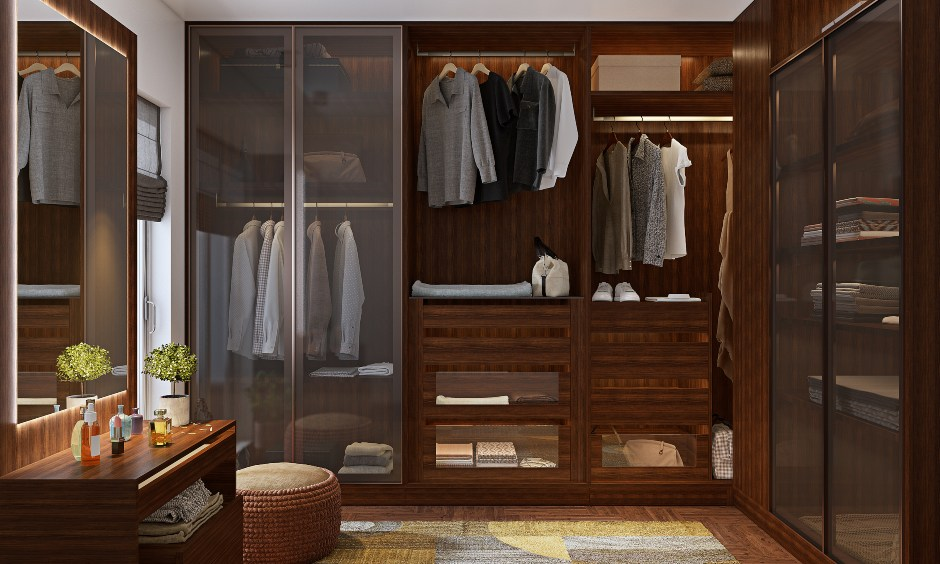 Walk In Wardrobe design with a large wooden walk-in closet with a dressing table for your master bedroom