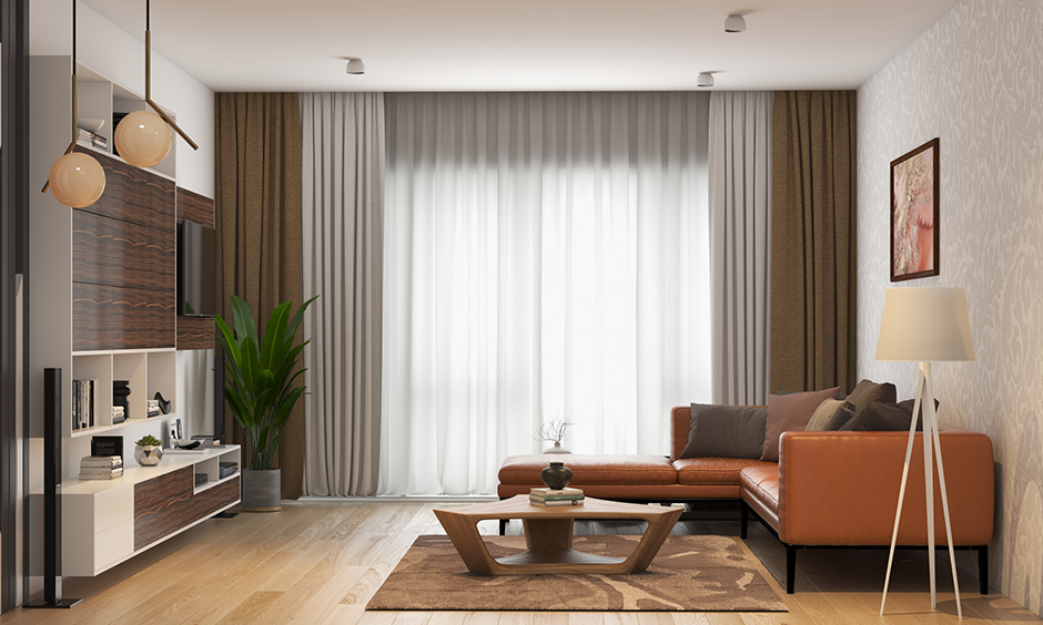 Brown wall colour which does well with brown furniture with whhite ceiling with leather sofa and white tv cabinet