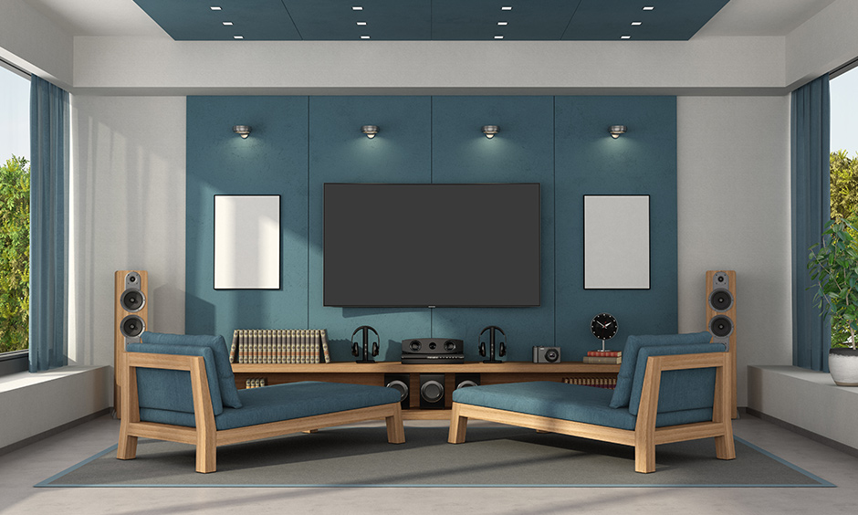An airforce blue home theatre room design looks elegant and straightforward.