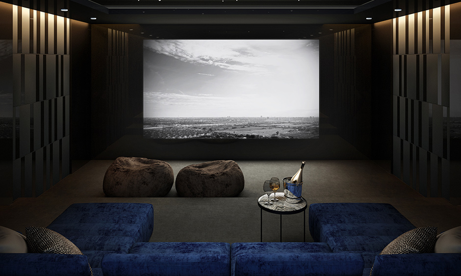 Designing a home theatre room choice that gives you an outdoor movie feel with a false ceiling intended to have lights to replicate stars.