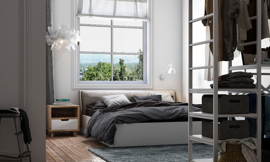 White bedroom design with a hydraulic bed and open wardrobe design