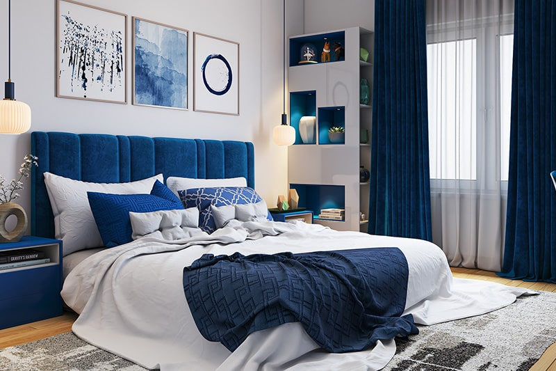 Bedroom colour combination with white painted walls and classic blue headboards