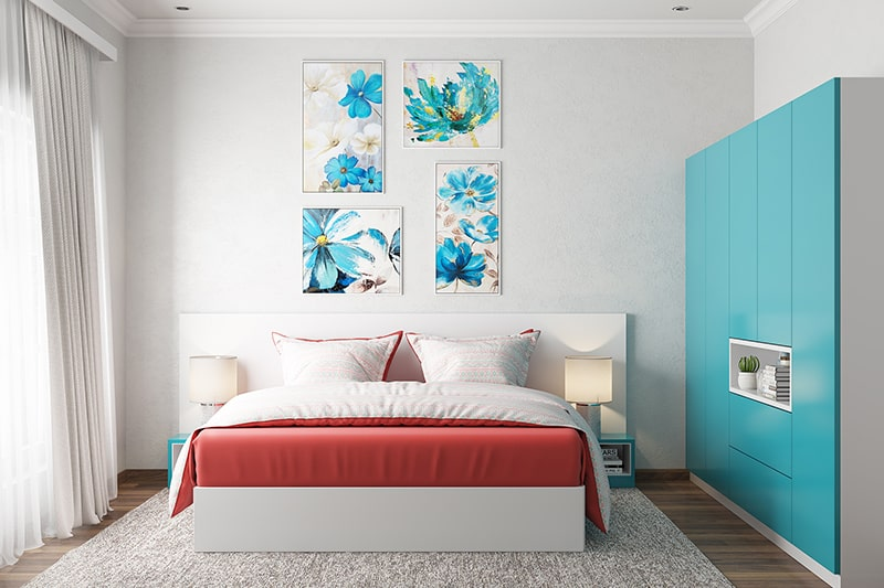 Small bedroom interior colour combination of red with a white background and a dash of blue